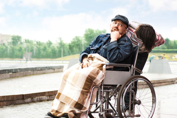 Sad man on wheelchair