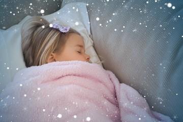 High angle view of a girl sleeping on sofa