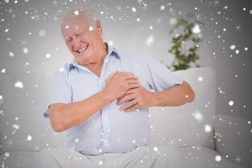 Composite image of old man suffering with heart pain