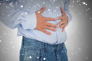 Closeup mid section of a casual man with stomach pain
