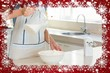 Mid section of woman pouring milk into dough at kitchen