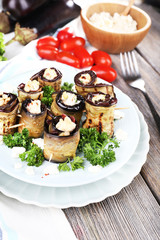 Fried aubergine with cottage cheese in a round plate