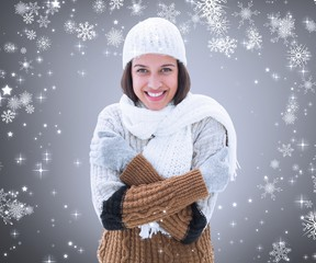 Composite image of brunette in warm clothing