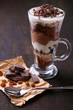 Yogurt, with chocolate cream, chopped chocolate and muesli
