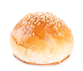 Tasty bun with sesame isolated on white