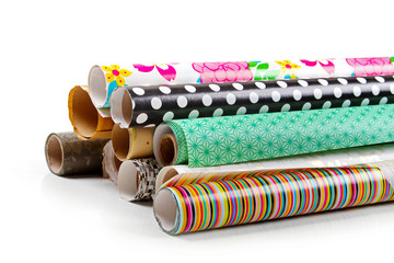 rolls of colorful wrapping paper isolated on white