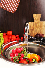 Fresh vegetables in sink in kitchen