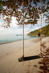Wooden swing on beach of Similan island, Thailand