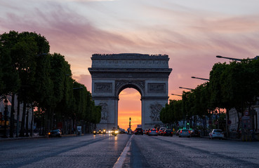 Arch of Triumph (Arc de Triomphe) with dramatic sunset behind