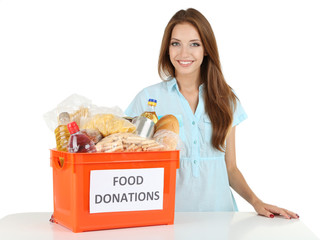 Girl volunteer with donation box with foodstuffs isolated