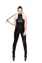 Sexy woman in latex catsuit holding handcuffs and bite whip