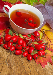rosehip tea and autumn leaves