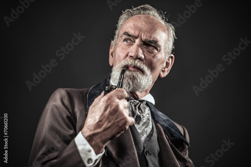 Pipe smoking vintage characteristic senior man with gray hair an - 70661200