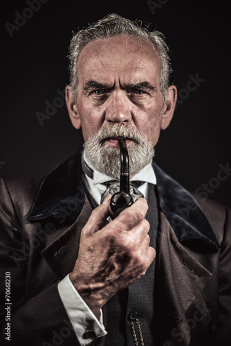 Pipe smoking vintage characteristic senior man with gray hair an - 70661230
