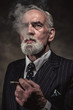 Cigar smoking characteristic senior business man with gray hair - 70661461