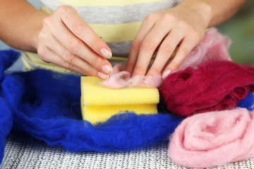 Woman working with wool close up