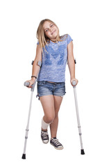 little girl with crutches isolated on white background