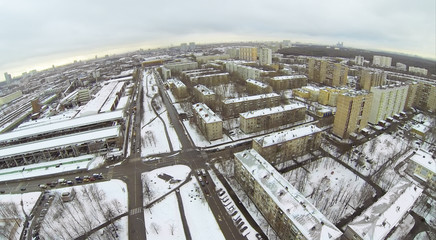Urban landscape with snow-covered streets on day, aerial view