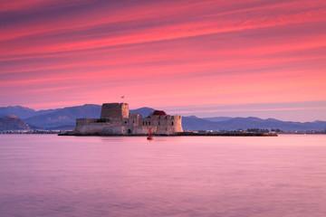 Sunset over Bourtzi castle in Nafplio, Greece.