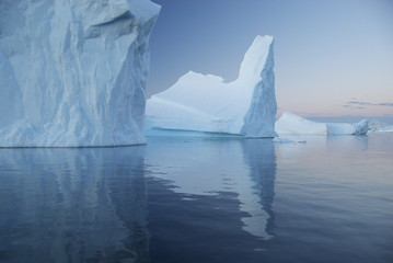 Reflection of blue icebergs (Antarctica)