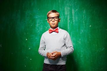 Boy by blackboard