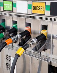 Close up of gas pump nozzles