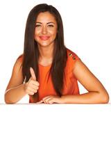 Girl in orange dress behind white board