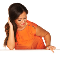 Girl in orange dress behind white board