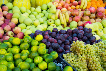 Variety of fresh organic fruits on the street stall