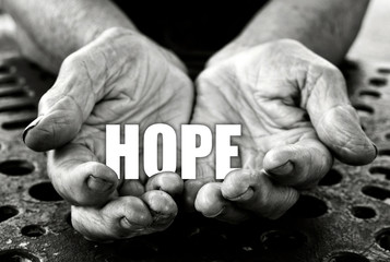 Hope concept in the old female hands