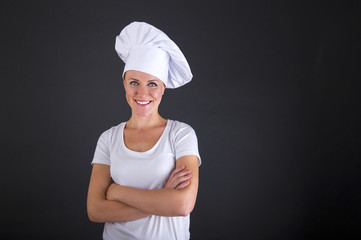 woman chef smiling over dark background