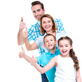 happy european family with children shows the thumbs up sign