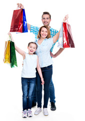 Happy american family with child holding shopping bags