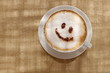 Coffee cappuccino with foam or chocolate happy face