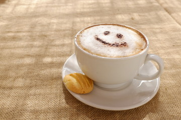 Coffee cappuccino with foam or chocolate smiling happy face