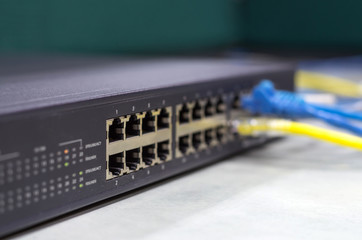 part of Network switch 24 port with LAN cable on the office tabl