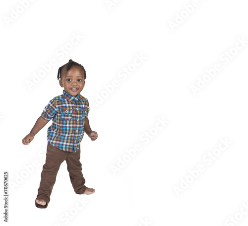 Fototapeta Young toddler isolated against a white background