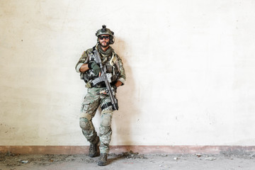 american soldier poses during military operation