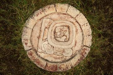 a carved Mayan calendar
