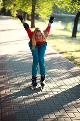 Happy young girl enjoying roller skating in park