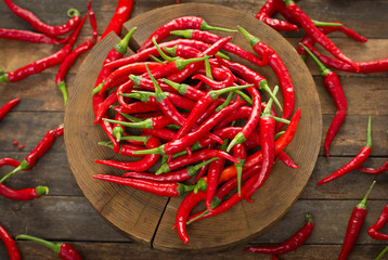 Red hot chili peppers on the wooden table