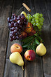 Still life with fresh fruits in wicker basket on wooden table