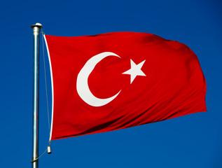 Turkish national flag over blue sky