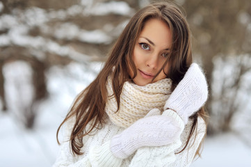Portrait of a beautiful girl in the winter