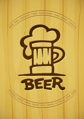 Sign of mug with beer contours silhouette on wooden