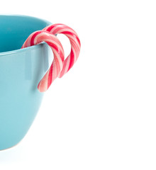 striped Christmas candy in a blue cup