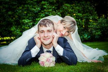 Happy young wedding couple on picnic