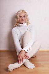 woman wearing turtleneck sweater and overknee socks