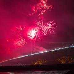 Fireworks over Forth road bridge, Edinburgh, Scotland, UK