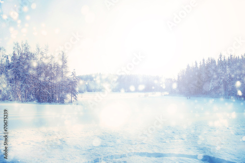 canvas print picture Winter background with lots of snowing white bokeh